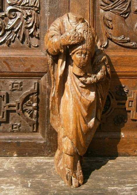16th Century Carved oak Figure of St Dennis