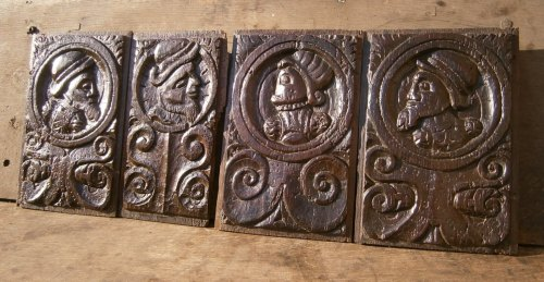 A Set Of Four 16th Century Carved Oak Romayne Profile Panels