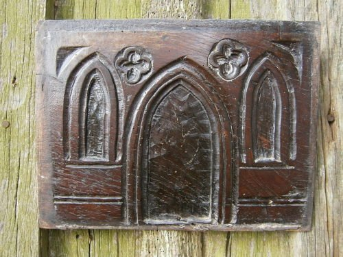 A 16th Century Gothic Oak Panel Depicting A Primitive Church Front