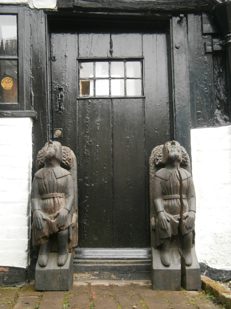 A Pair Of Henry VIII Period Carved Oak Corbels Possibly Depicting Sir Willi