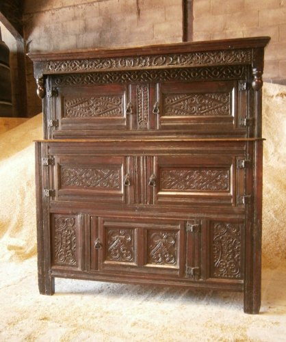 A 17th Century Westmorland Carved Oak Court Cupboard dated 1692