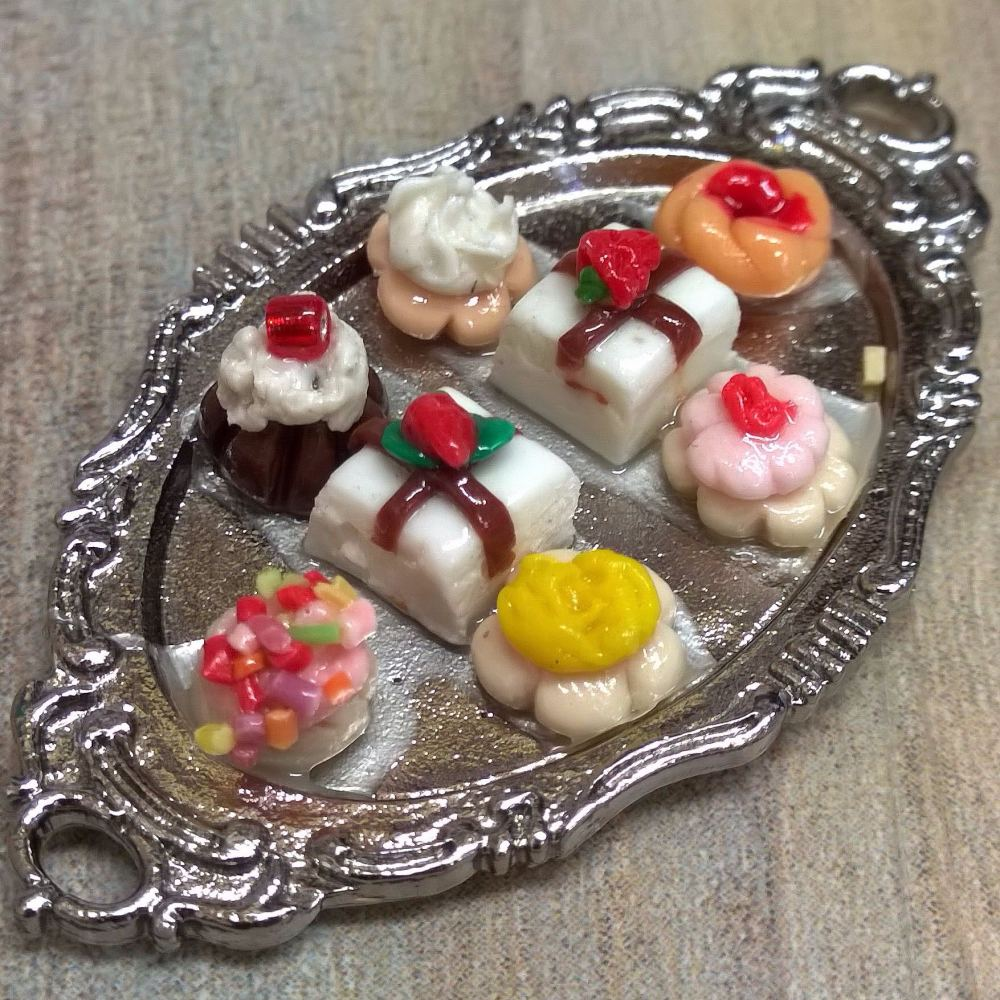 Cakes on a Silver Coloured Tray