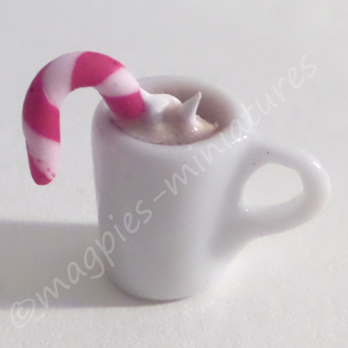 Hot Chocolate with candy cane and cream