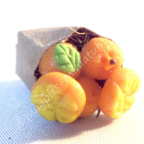 Brown paper bag groceries - oranges persimmons