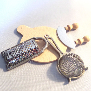 Chopping board, herb chopper, cheese grater, sieve