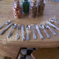 Silver coloured cutlery - 4 place settings