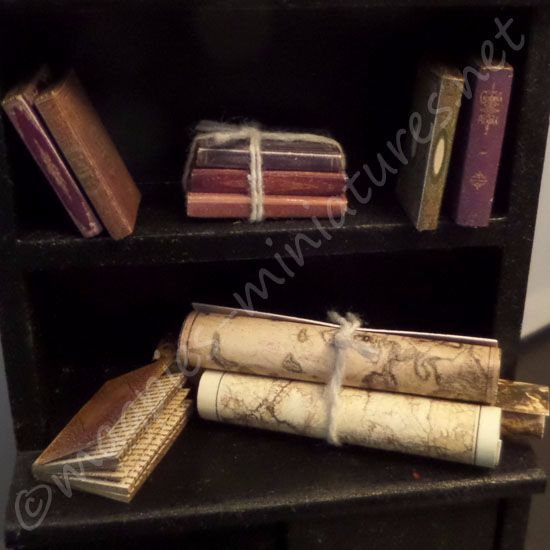 8 Antiqued books and 3 vintage style maps