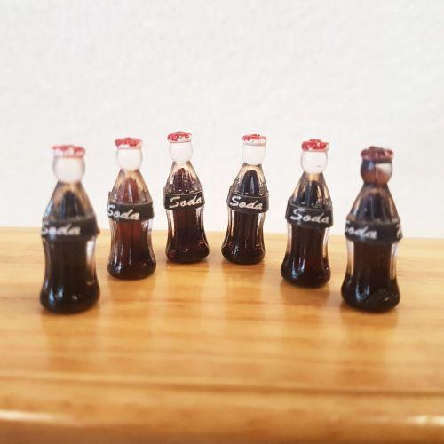 6 Cola Bottles