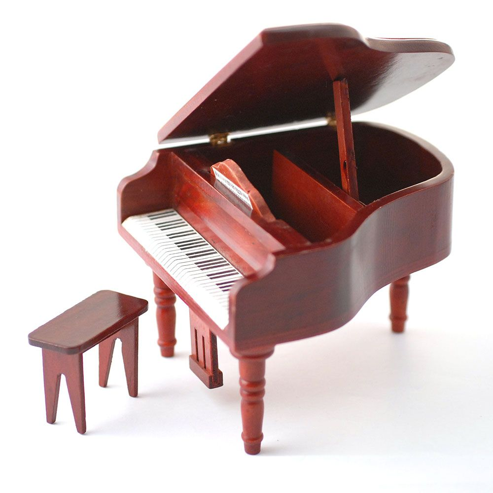 Grand Piano and stool.