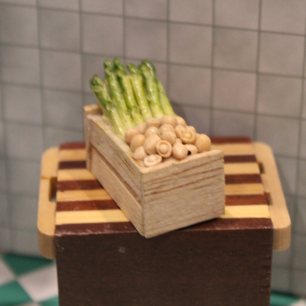 Asparagus and Mushrooms in a Wooden Crates