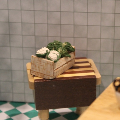 Cauliflower and Broccoli in a Wooden Crate