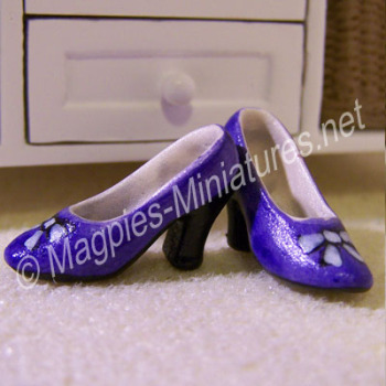 Pair of ladies shoes - purple bow