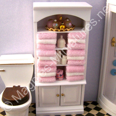 White Cupboard Pink Towels