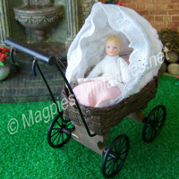 Brown Wicker Pram And Baby