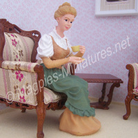 Lady Sitting Holding Cup