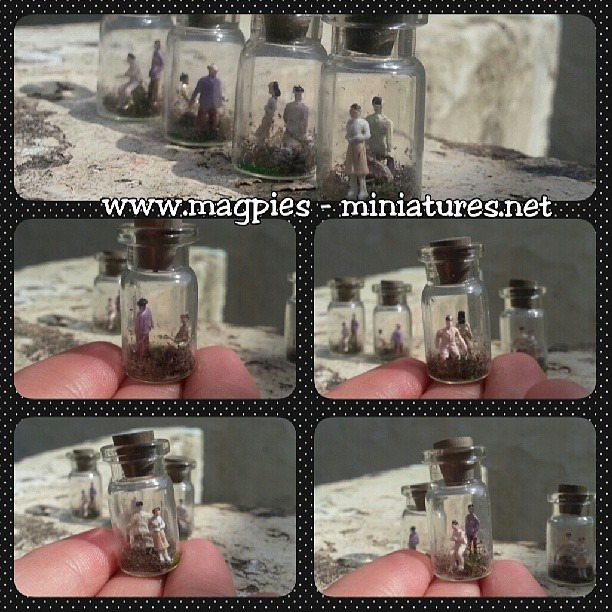 Tiny people trapped in jars