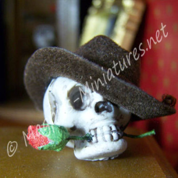 Plastic Skull with Hat and Rose