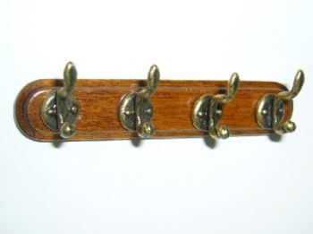4 Coat hooks on Walnut wood bar