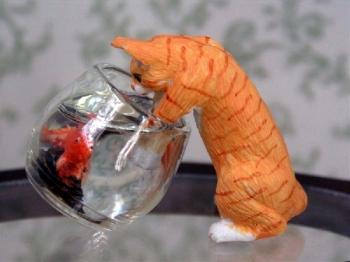 Cat And Goldfish Bowl