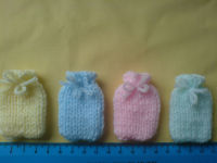 4 Hand Knitted Hot Water Bottle Covers--REDUCED TO CLEAR