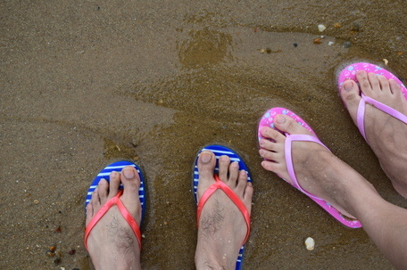Clacton on sea blue and pink slippers on beach