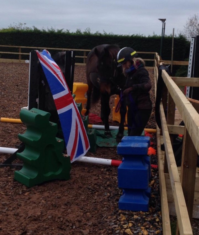 Helping a horse build confidence with entering narrow spaces, to overcome her fear of loading.