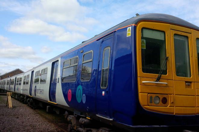 Northern class 319 EMU stabled in siding