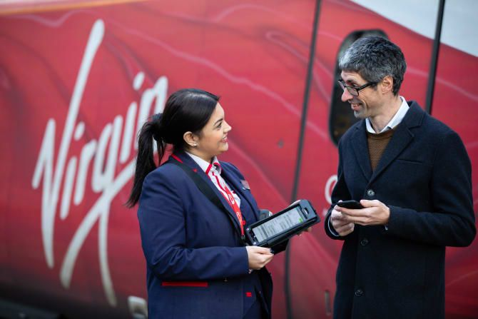 Virgin Trains staff holding new handheld devices