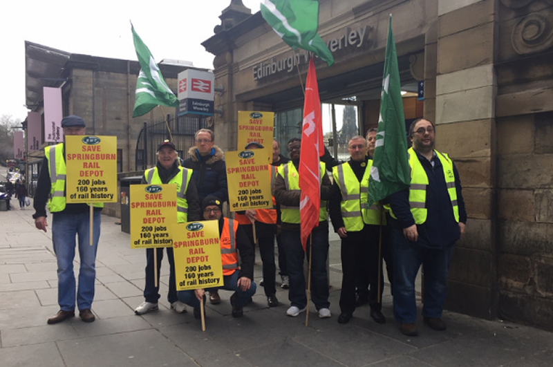 RMT members stage protest outside Edinburgh Waverley station.