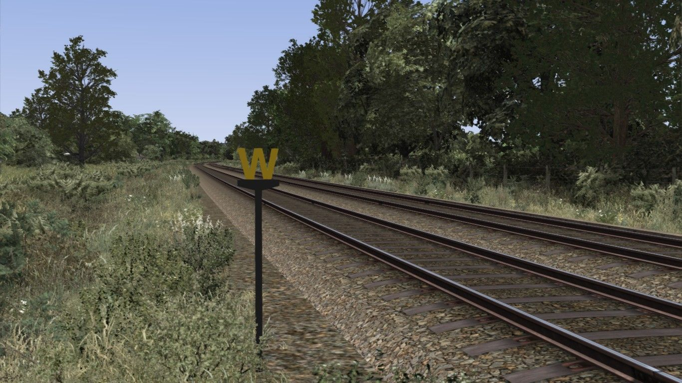 Image depicting a lineside cut-out whistle sign.