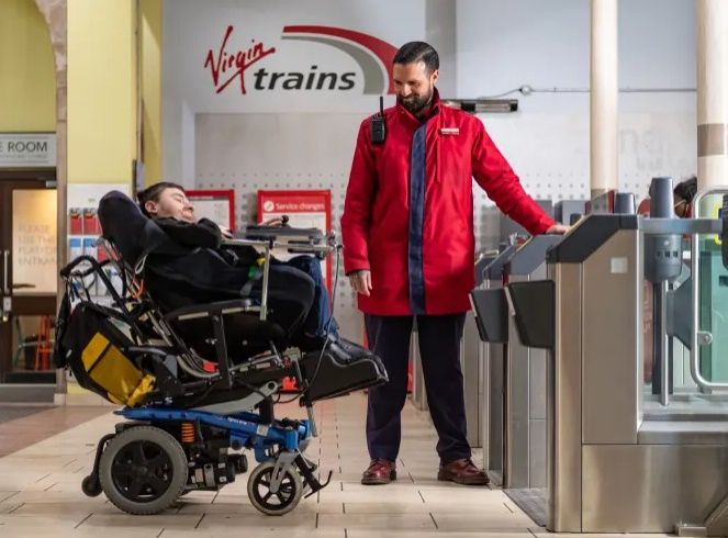 Image showing Virgin employee assisting disabled customer