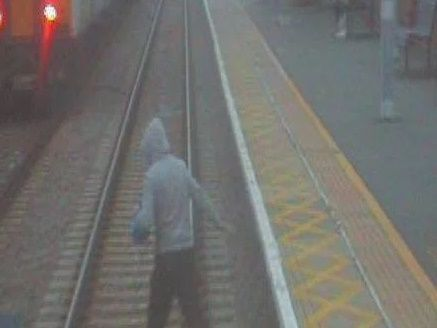Image showing a trespasser on the railway line