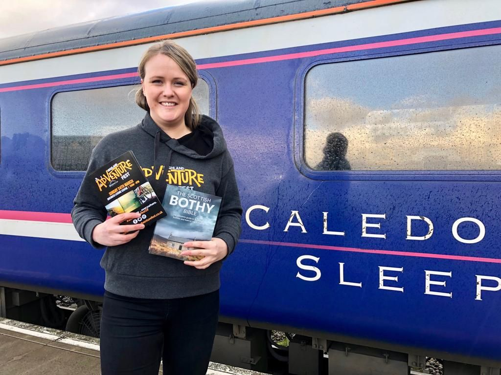 Image showing Highland Adventure Fest representative standing in front of Caledonian Sleeper carriage