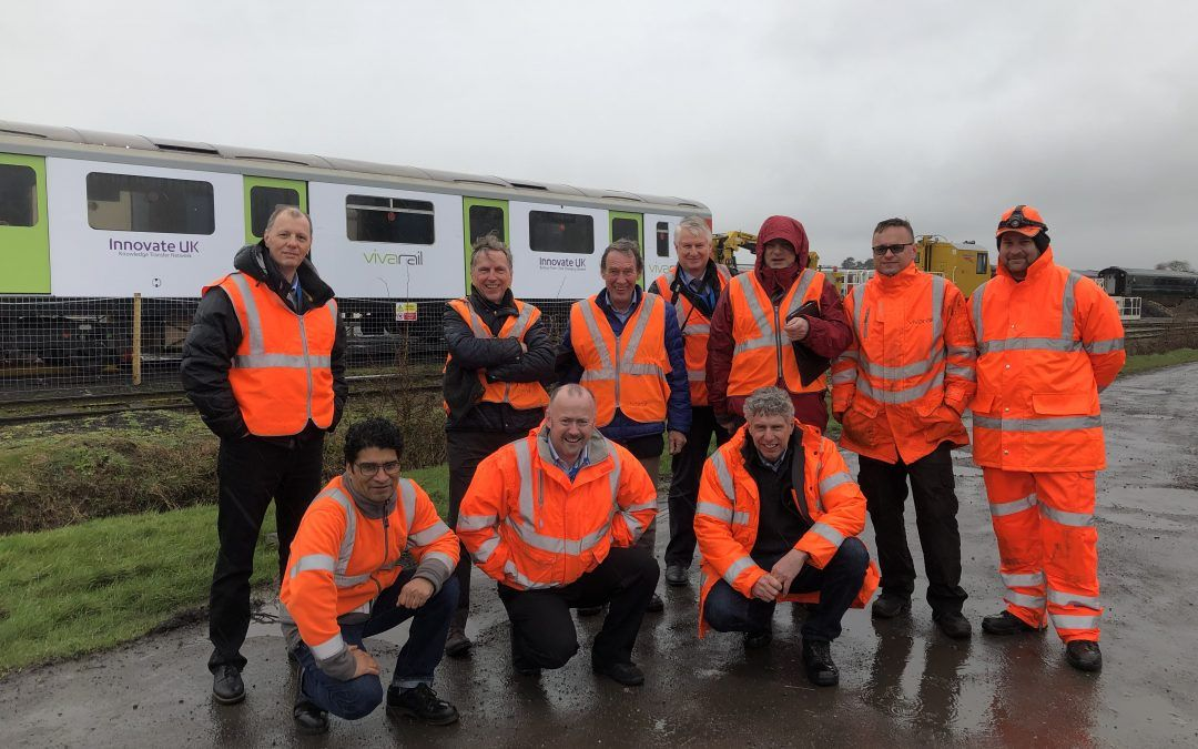 Image showing engineers stood with a Vivarail Class 230 train