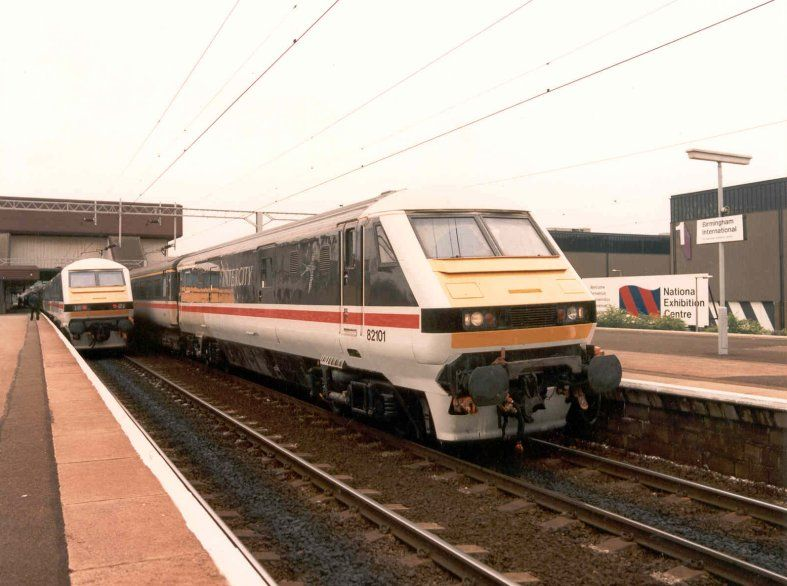 Image showing 82101 standing in Birmingham International station in the company of a sister DVT not long after their introduction