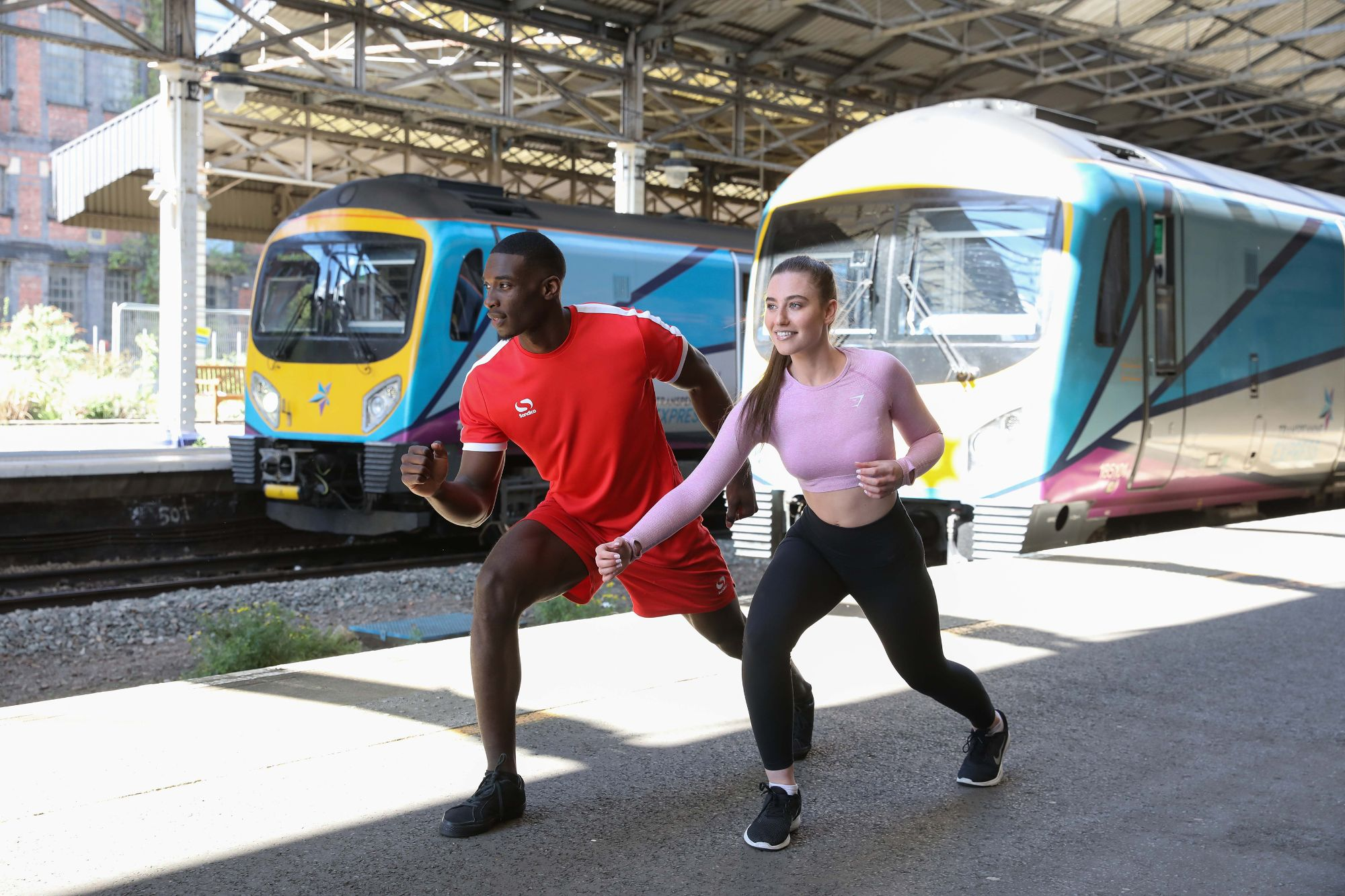Image showing athletes in front of TransPennine Express trains