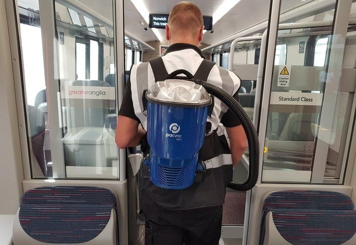 Image showing Greater Anglia employee wearing cleaning equipment