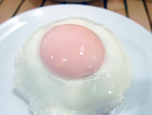 pink fried egg