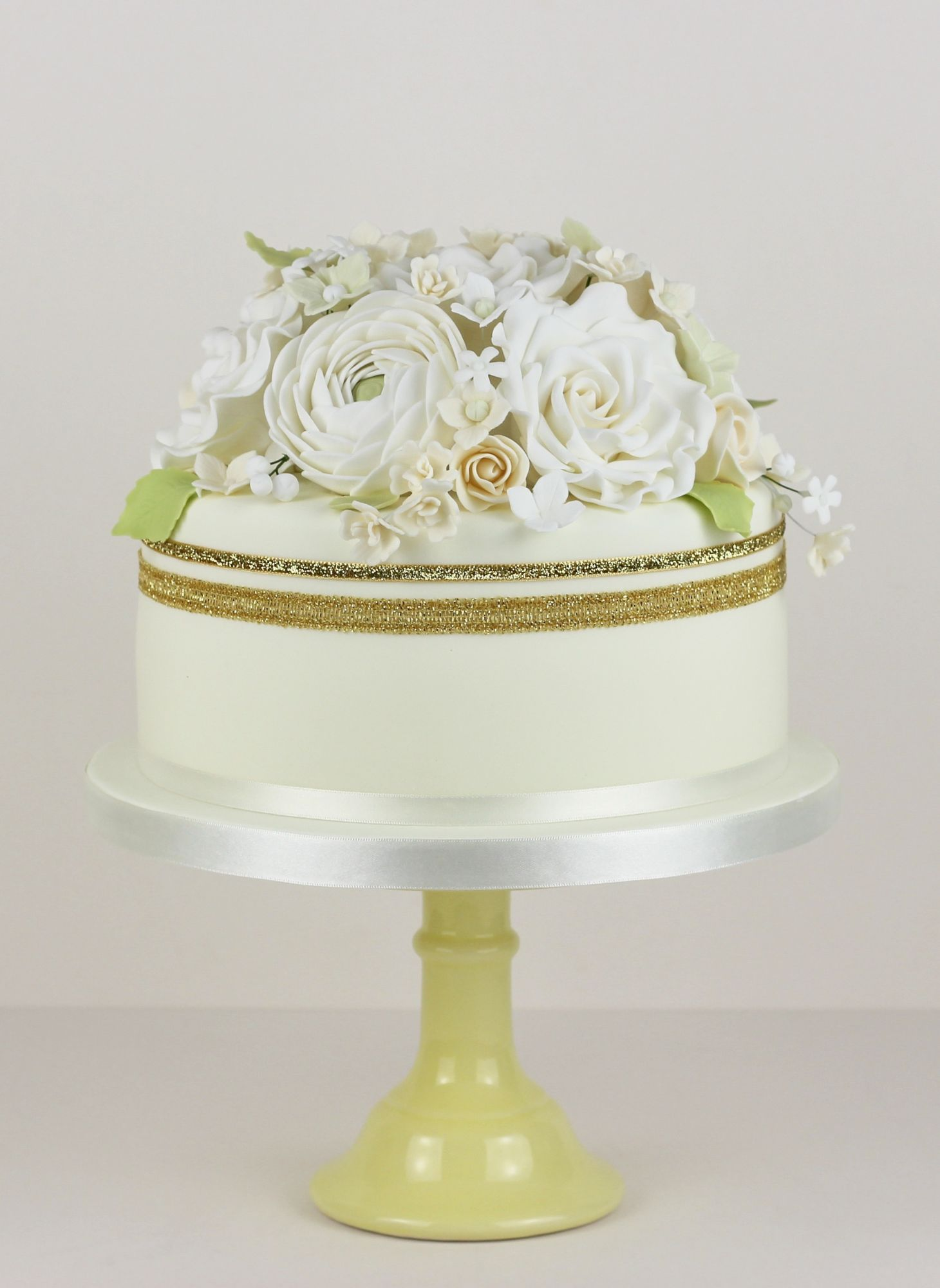 Full flower cake topper with a mixture of sugar flowers