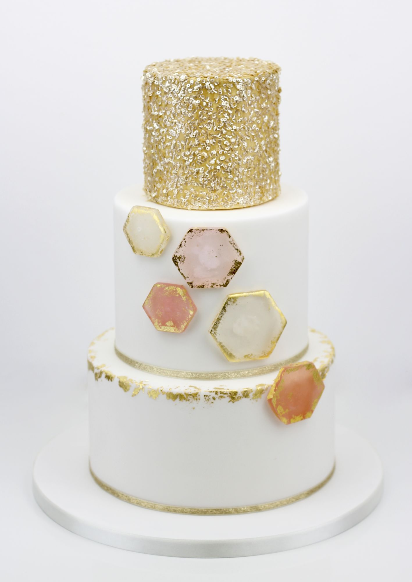 Gold edible sequins with sugar gold leaf hexagons  wedding cake
