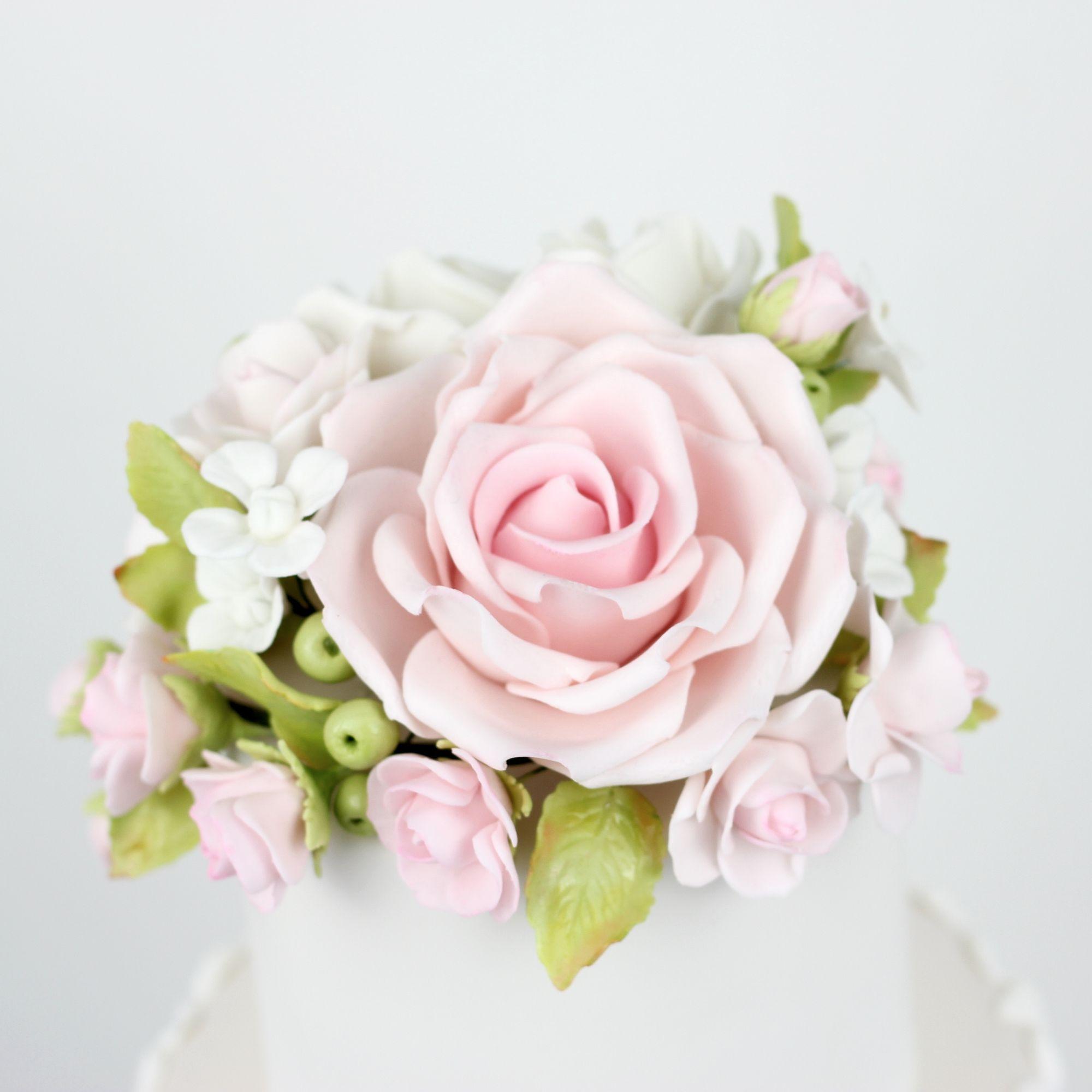 Pink rose, hydrangeas and berries.