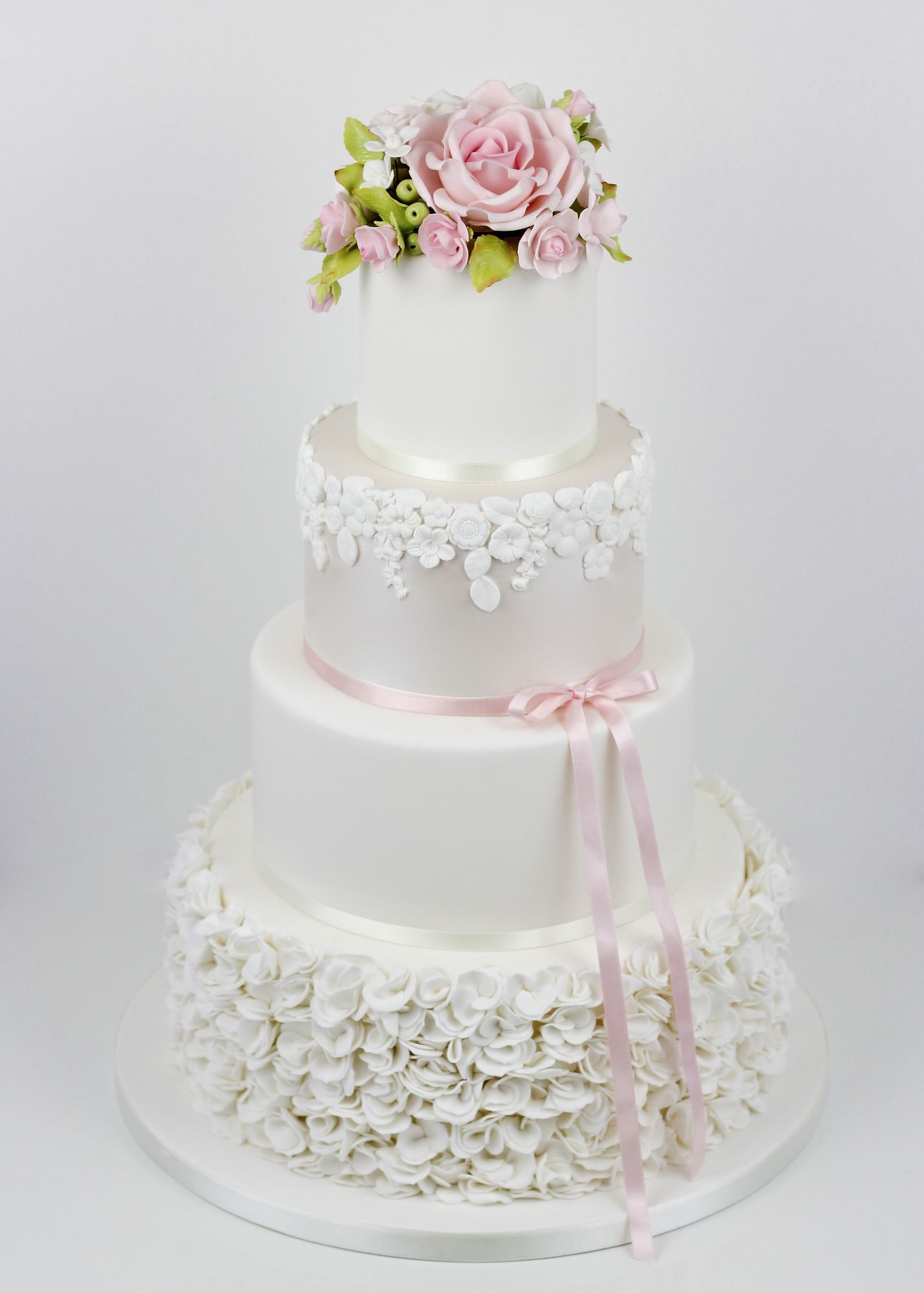 Scrunched ruffles with lustre and  rose topper
