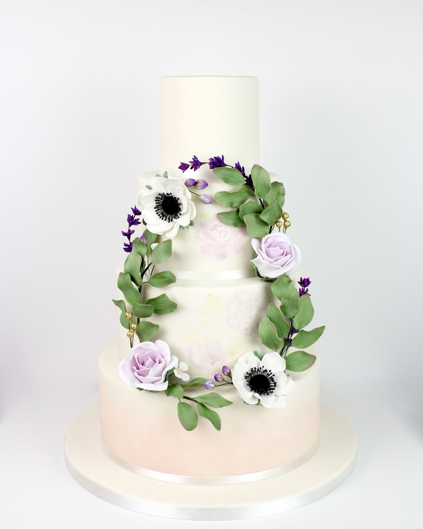 Watercolour flowers and bottom tier hand painted with floral wreath with roses, lavender and anemones, sugar flower garland