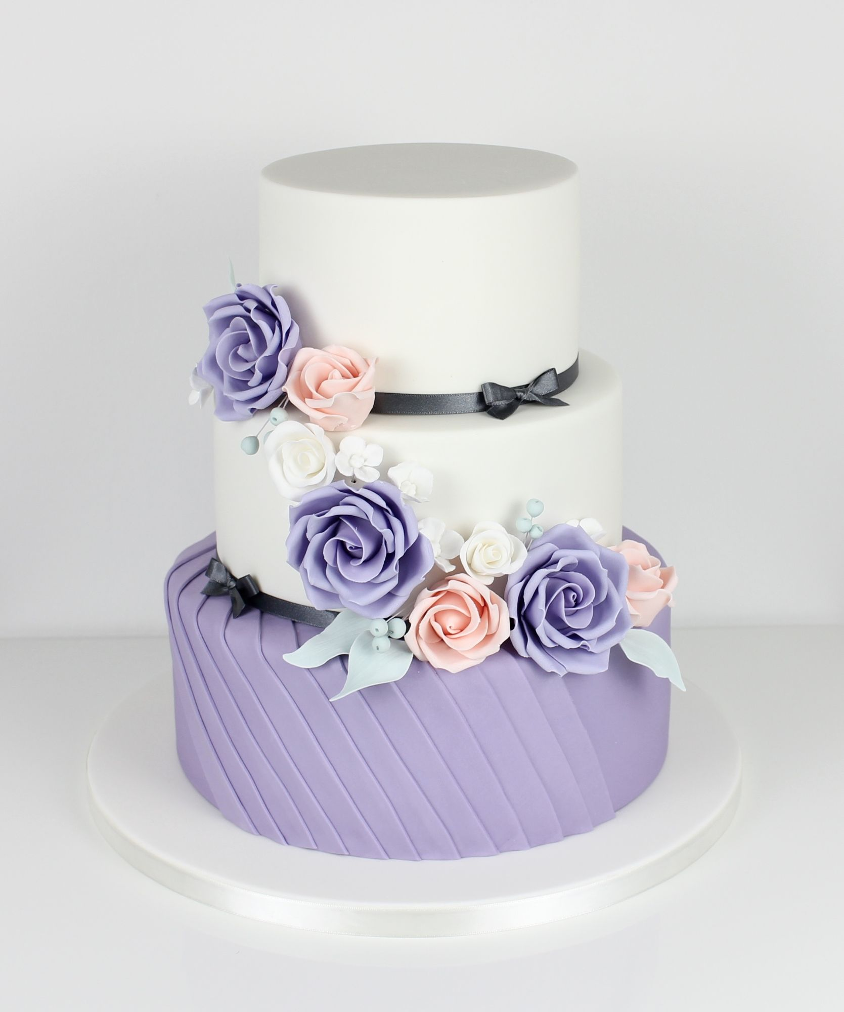 Pleated purple tier with cascading roses.