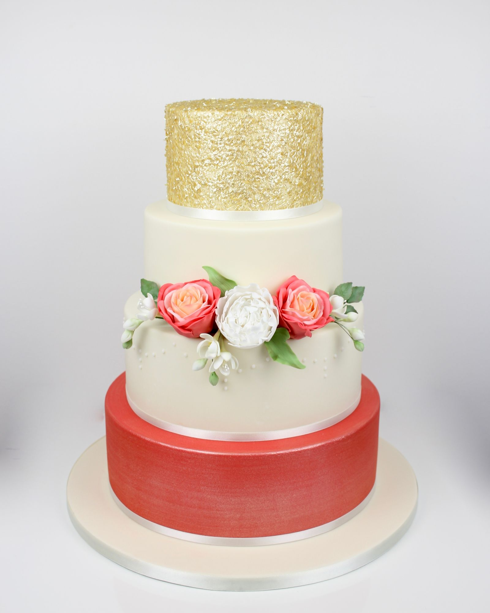 Coral & gold wedding cake