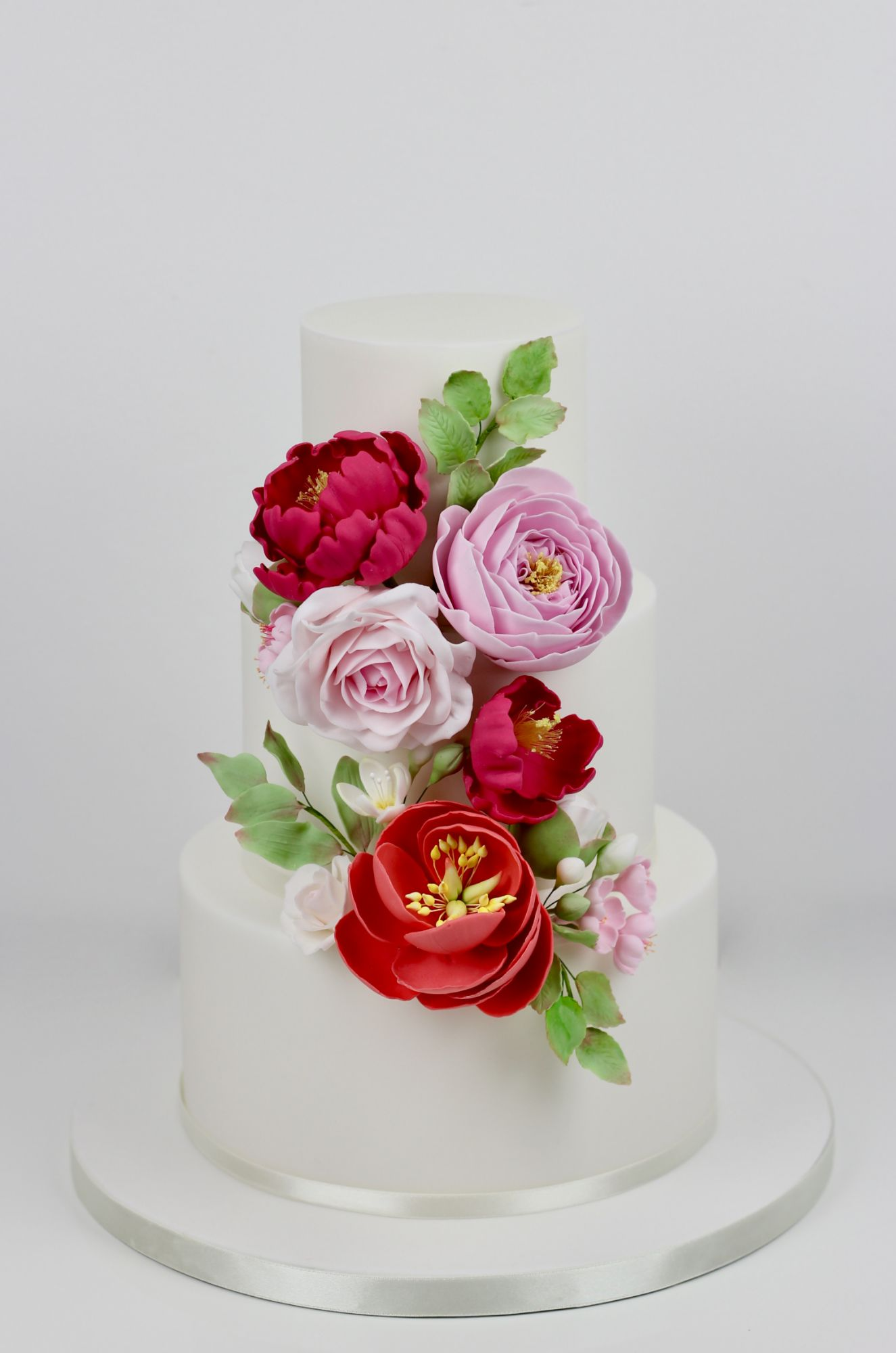 Summer time, bright wedding cake with bright coloured flowers