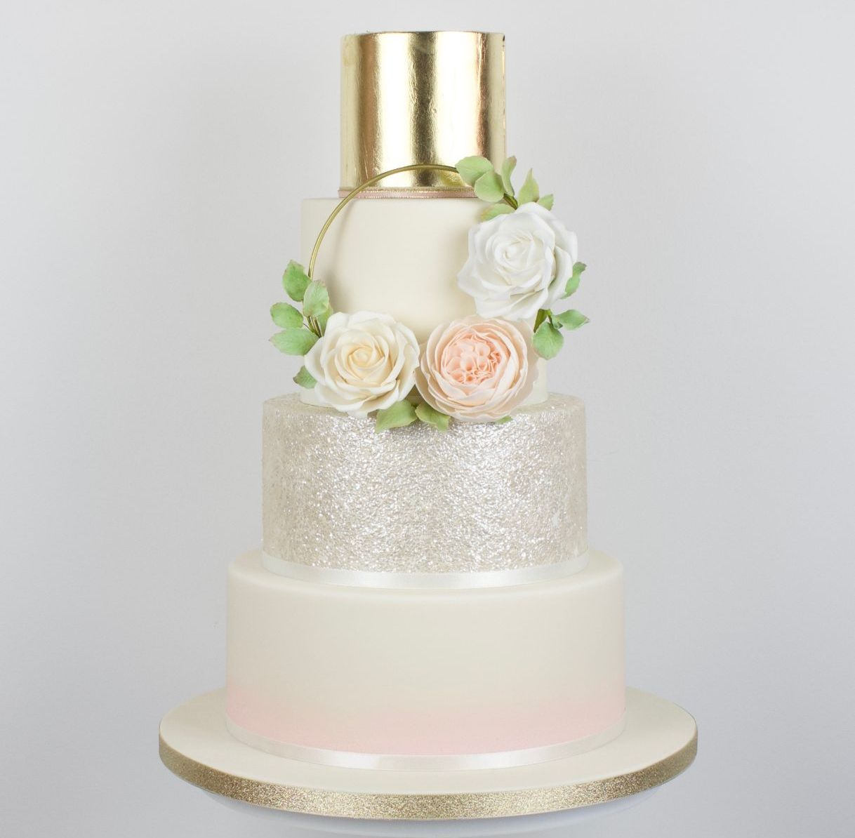 Ombre, glittered wedding cake with gold florl hoop and edible gold leaf