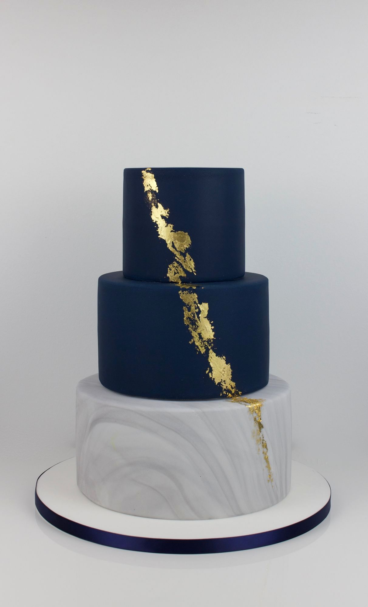 Navy, marble and edible gold leaf
