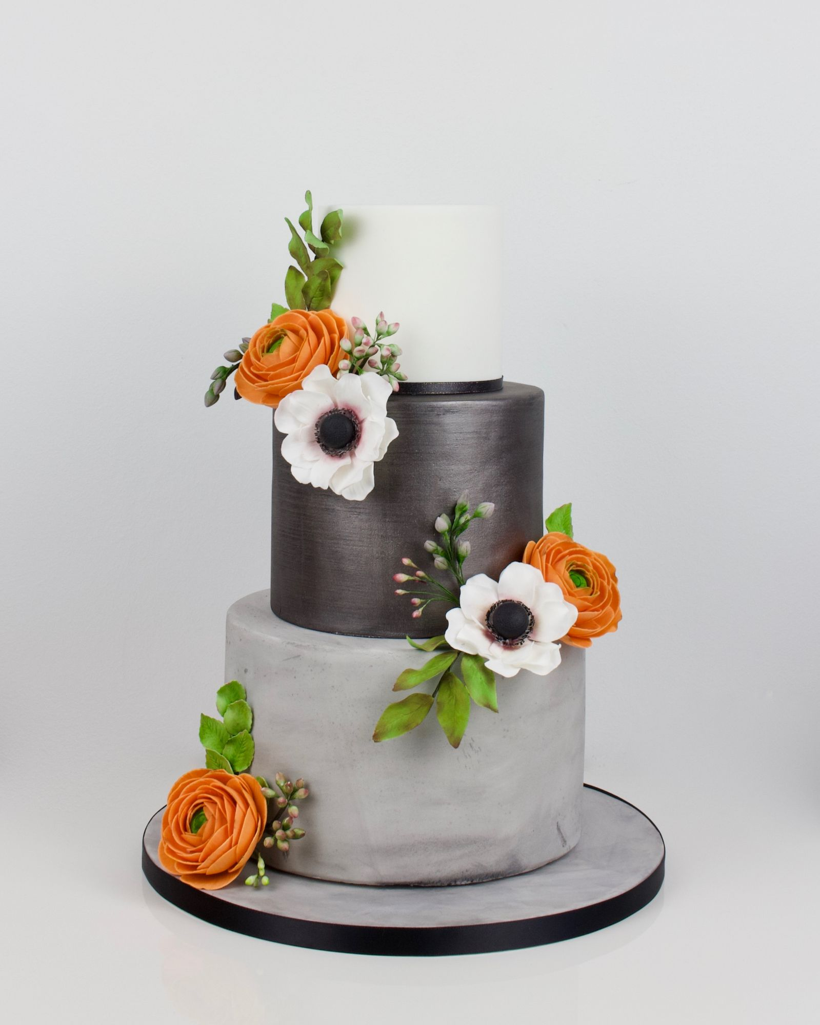 Concrete effect, lustre and orange ranunculus