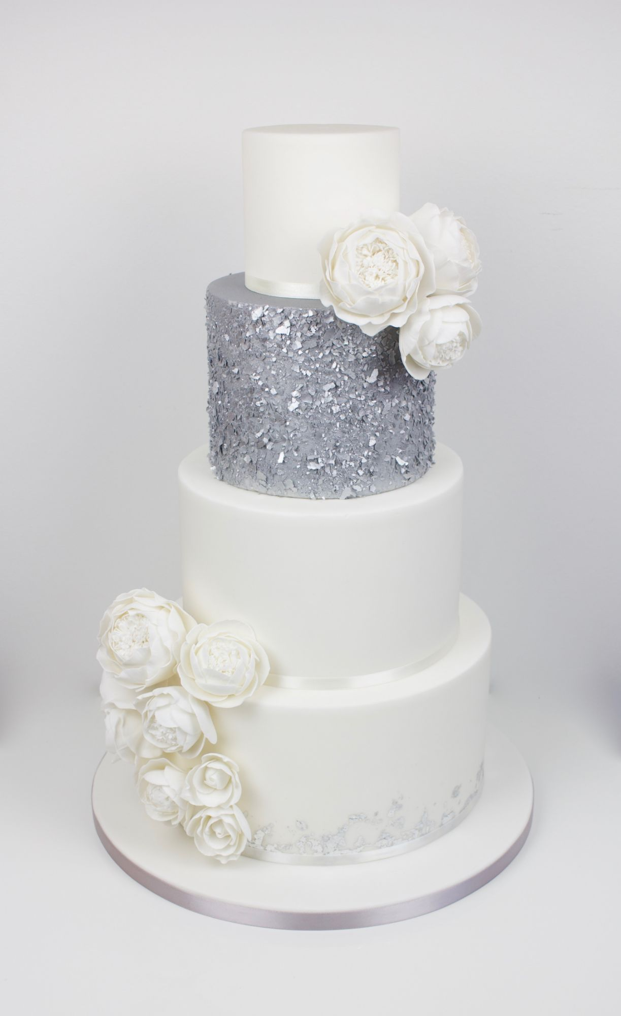 Silver 4 tier wedding cake with white garden roses